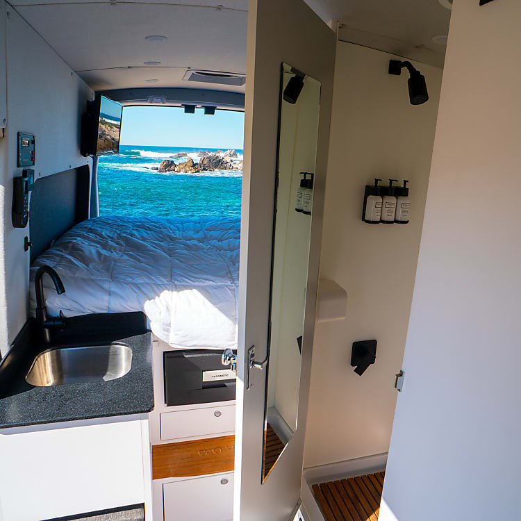 Large shower with teak floor and corian shower surround is the best bathroom on four wheels that you can find, and stocked with Beekman 1802 shampoo, conditioner and body wash.
