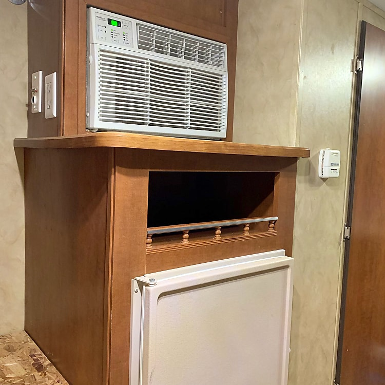Air conditioning above, Norcold AC/DC refrigerator; keeps food cold while you're on the road