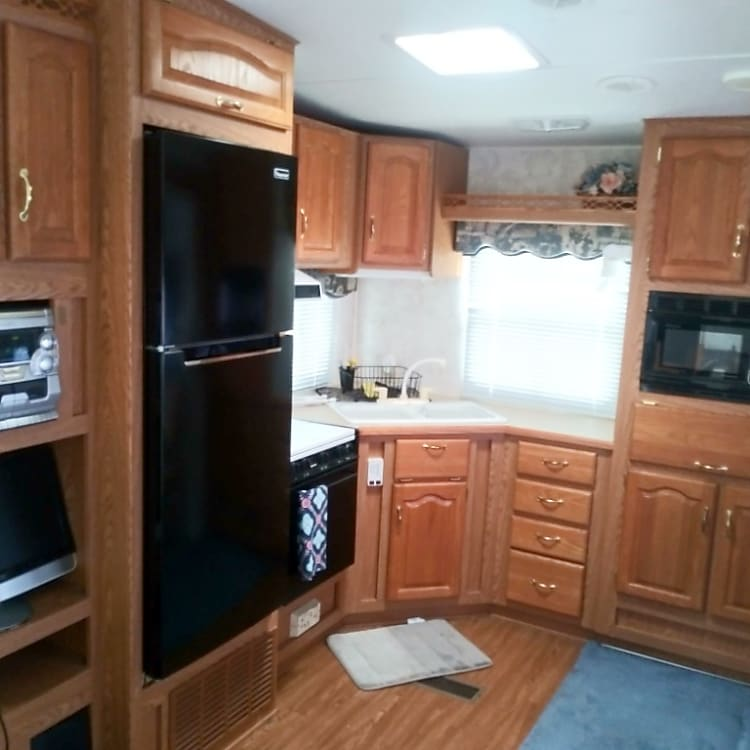 Rear kitchen design allows for more space.