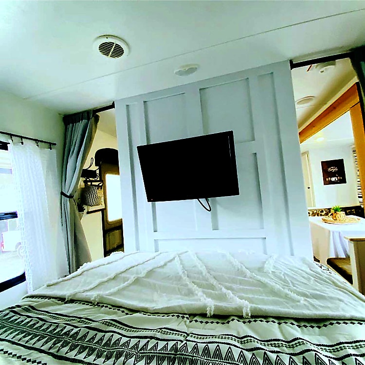 The bedroom. the bed is a queen with a very comfortably memory foam mattress. the curtains close to give you privacy.
