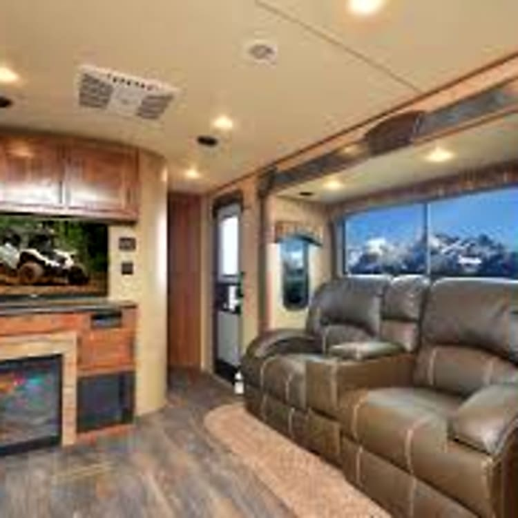 Comfortable recliners and fire place.