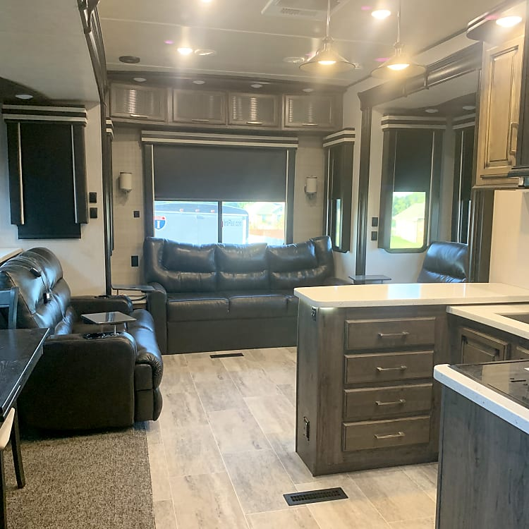 Large open kitchen/living in rear of fifth-wheel.