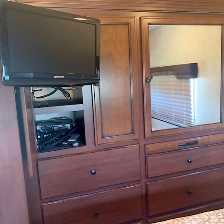 Master wardrobe and TV