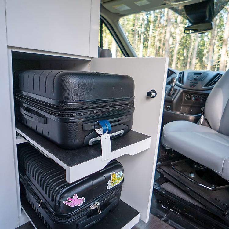 Store your luggage conveniently in our carry on sized luggage compartments!