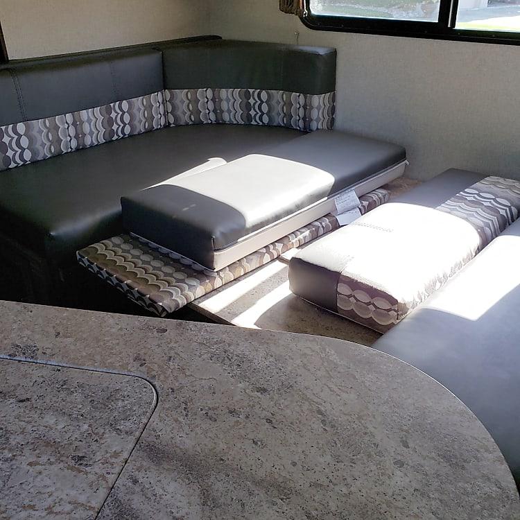 Convertible table/sofa/bed.
