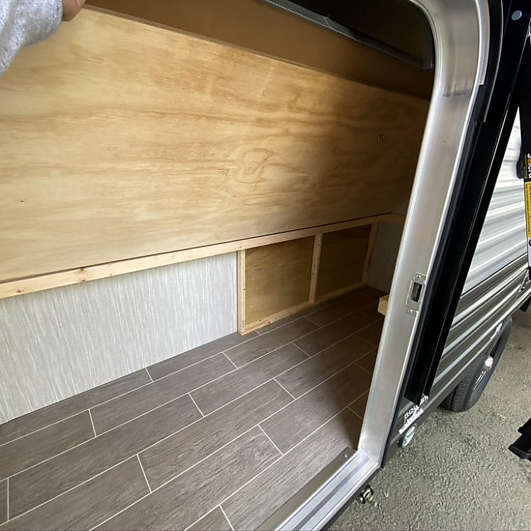 View of lower bunk folded upward.