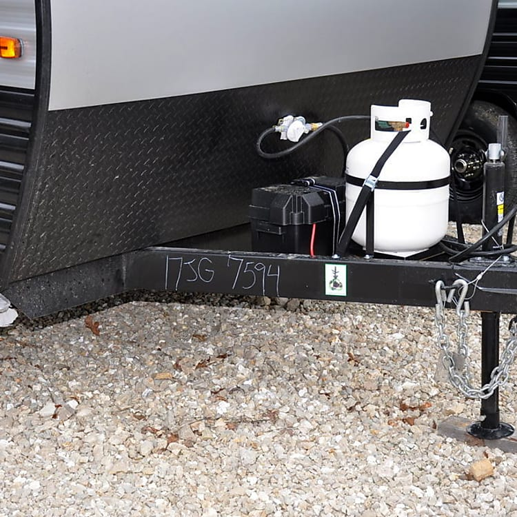 Front of Trailer displaying propane tank (~5 gallon/20lbs) and battery. 430lb hitch.