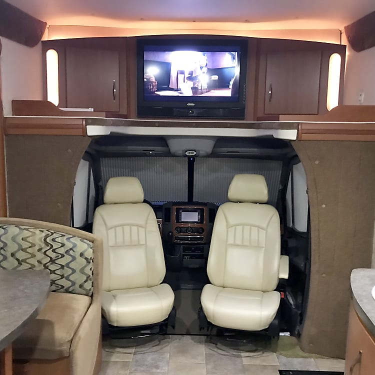 Entertainment Center and caption chairs