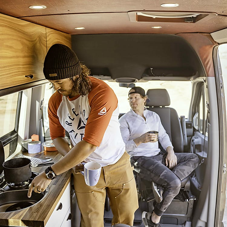 Small cooktop and sink inside the van.  Plenty of room to hang out inside the van as well.