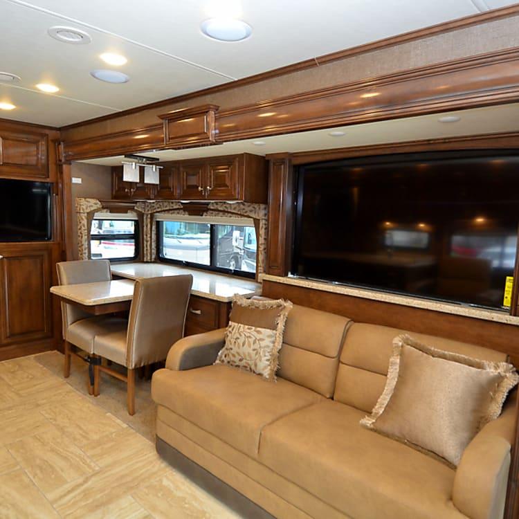 """65"""" HD TV in living room"""