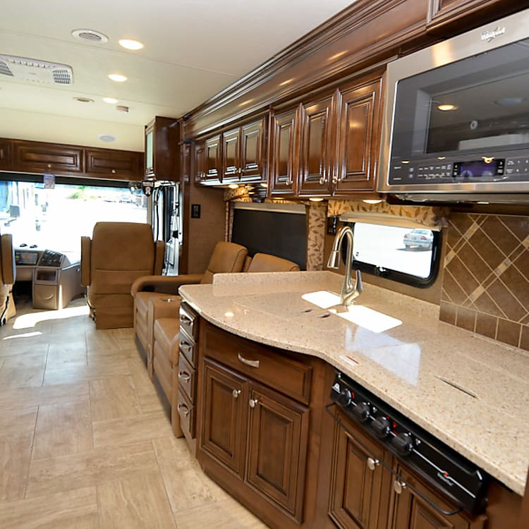 Full kitchen, convection microwave, three burner LPG stove with all cookware
