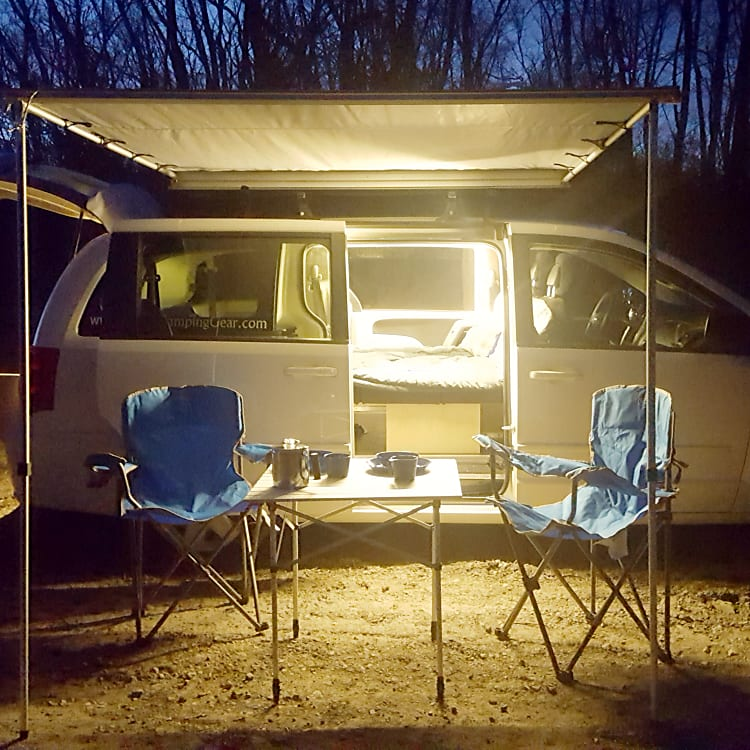 The Lucy van fully lit and  set up for a cozy night of camping. 3 LED light strips on separate switches give you as much or as little light as you desire.