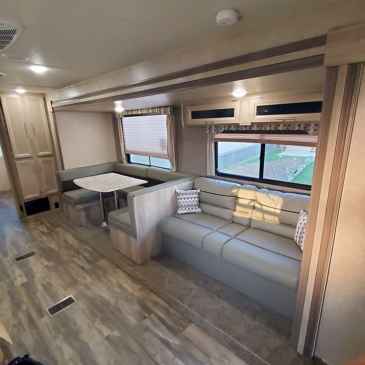 Couch, pulls into sleeper with overhead storage