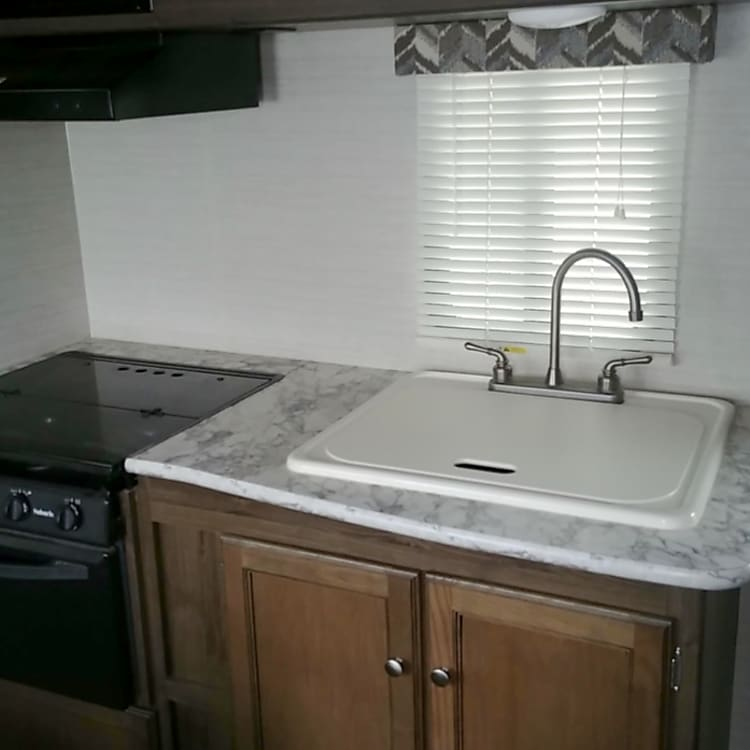 Fully stocked! Kitchen sink,oven, stove, microwave