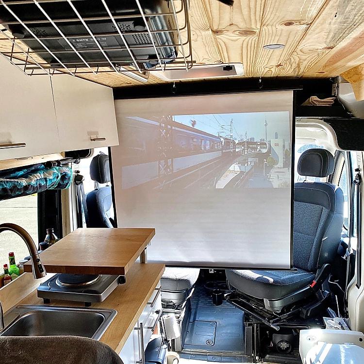 Drop down screen for indoor or outdoor theater set up