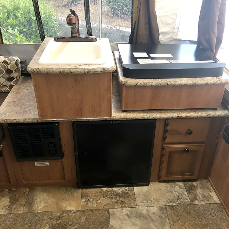 Heater, fridge, sink and stove