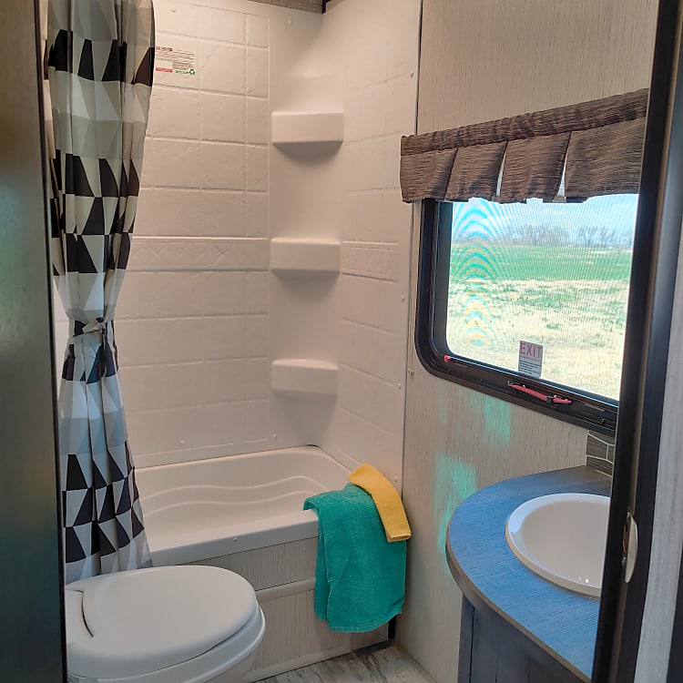 Full bathroom with shower and small tub