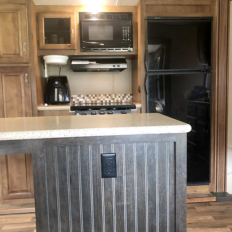Kitchen island provides plenty of room for cooking.
