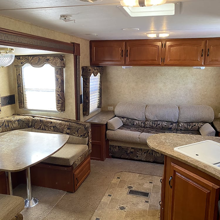 Room for the whole family! Space to visit and play games. Table bed and fold out couch provide more sleeping areas.