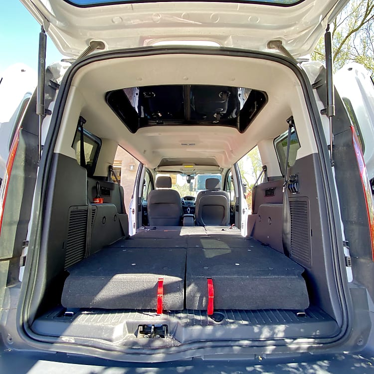 A view with the seats down feature the pass through with over six and a half feet of headroom. This is great for changing.