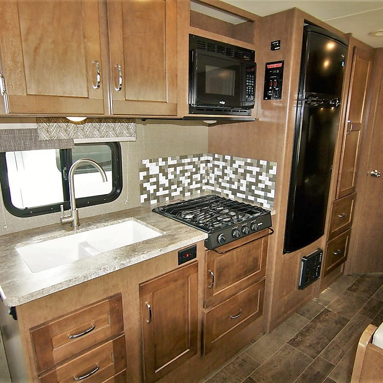 Great size kitchen sink, 3 burner stove and Microwave