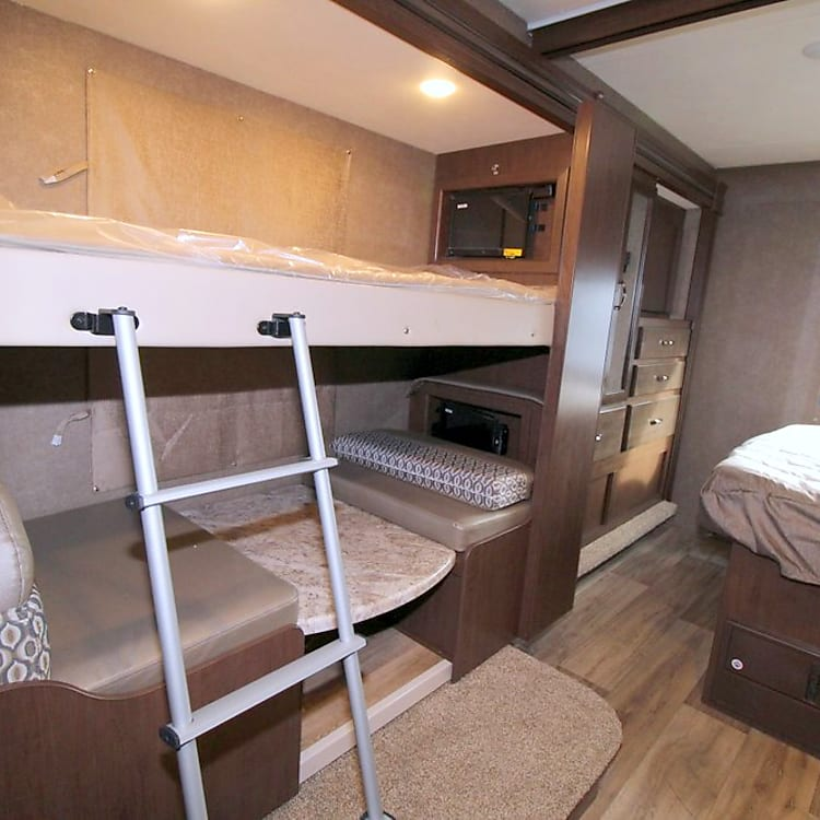 bunks and 2nd dinette w/ TVs
