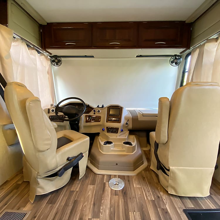 Roomy and comfortable with round table to insert if desired while driving.