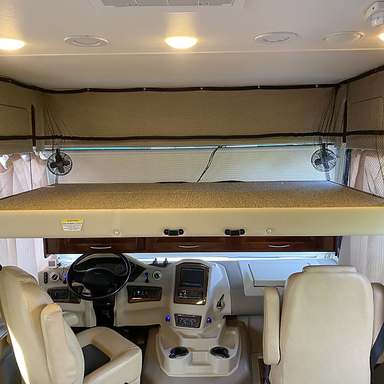 Electric raise/lower Cab over bed - access is with a ladder stored in the belly.