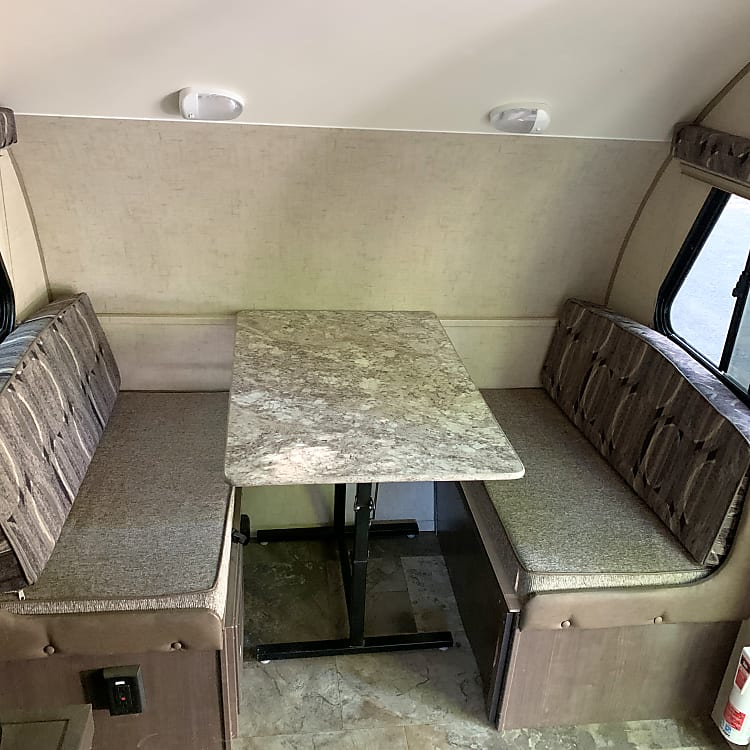 Dinette on the front. Converts to full bed.