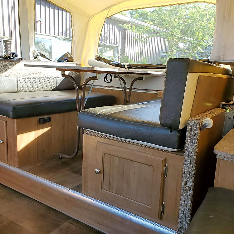 Pull out eating area adds space and can convert to a bed