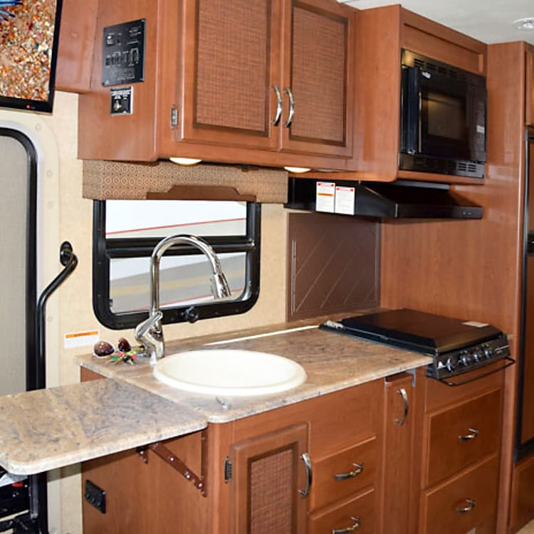 kitchen with extended counter surface and exterior door. tv above the door