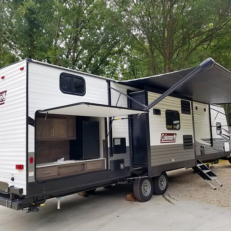 Side pic of camper and outdoor kitchen