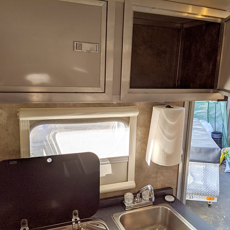 Stove and sink with storage above