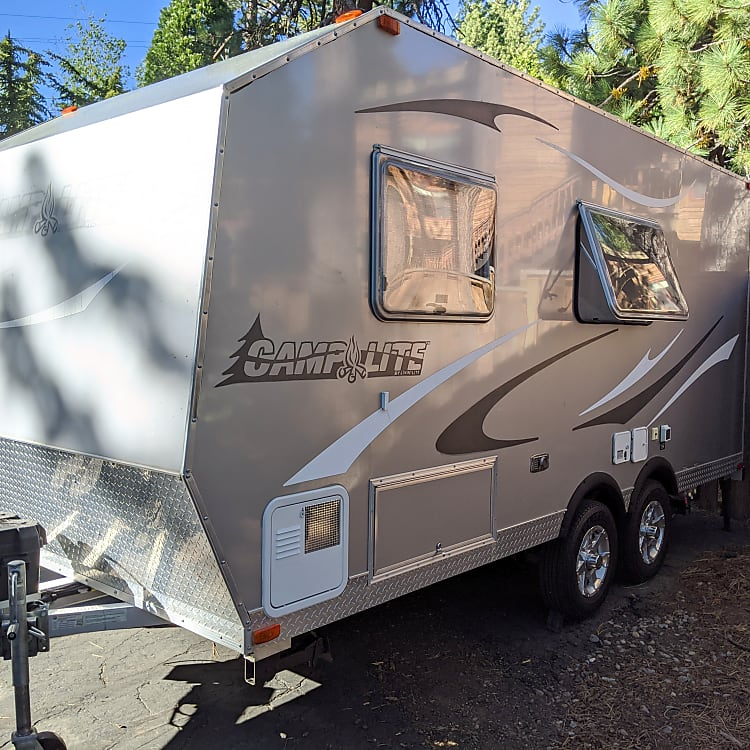 Front/side view with storage accessible from outside or inside the trailer