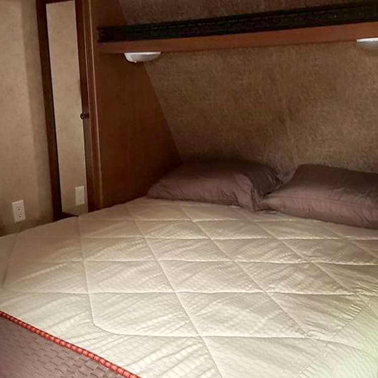 Queen sized bed with memory foam topper. Bedding provided.