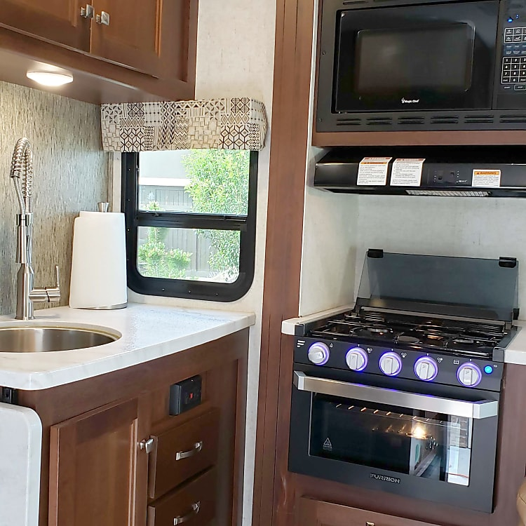 Kitchen with Stove, Oven, and Microwave