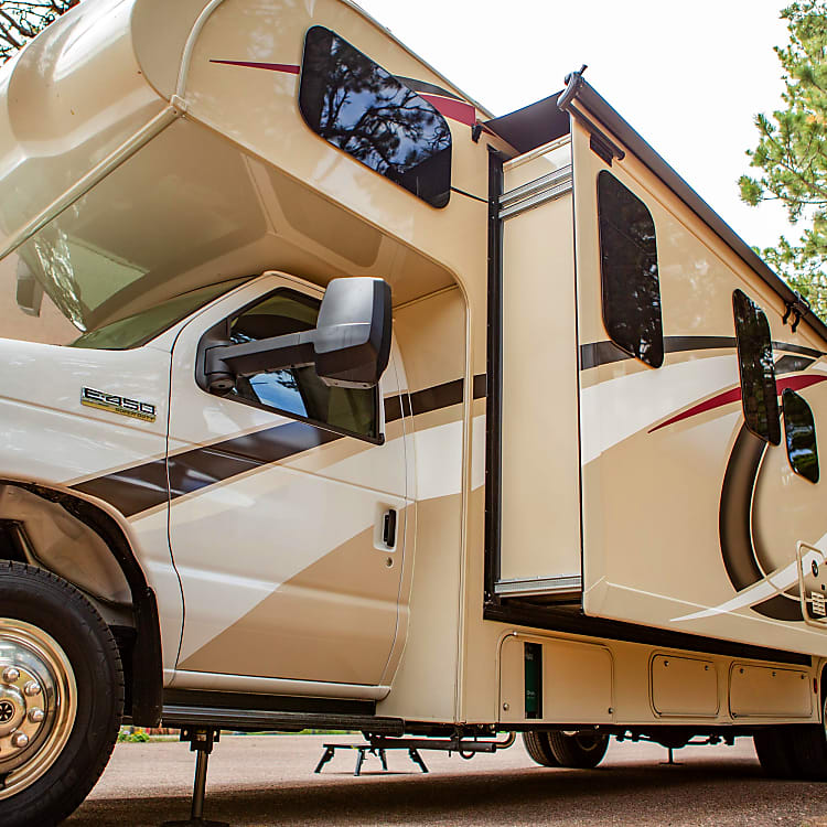 With two slide-outs, the RV comfortably sleeps six and has three beds, including two queens