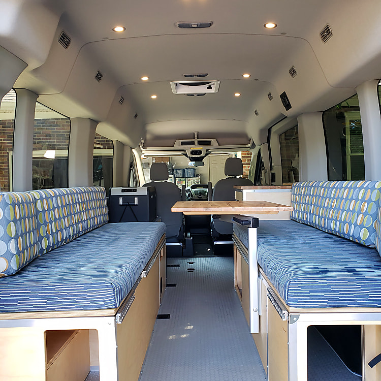Rear View - Bench seats with storage below, converts to queen size bed.  Swivel lagun table.