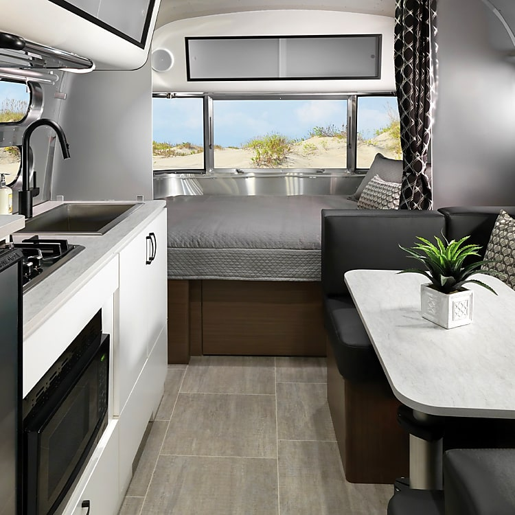 Farmhouse sink, microwave and stovetop, flatscreen TV, queen bed