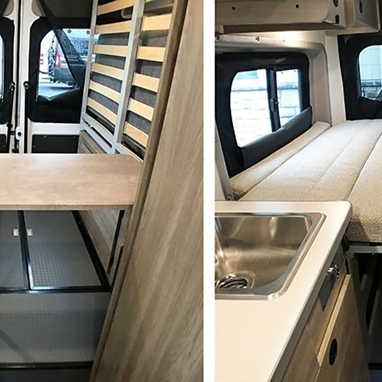 Versatile rear area transfers from a lounge/dinette to a bed that can sleep two