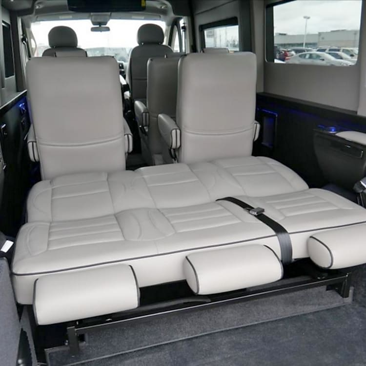 Rear seat reclines to sleeper