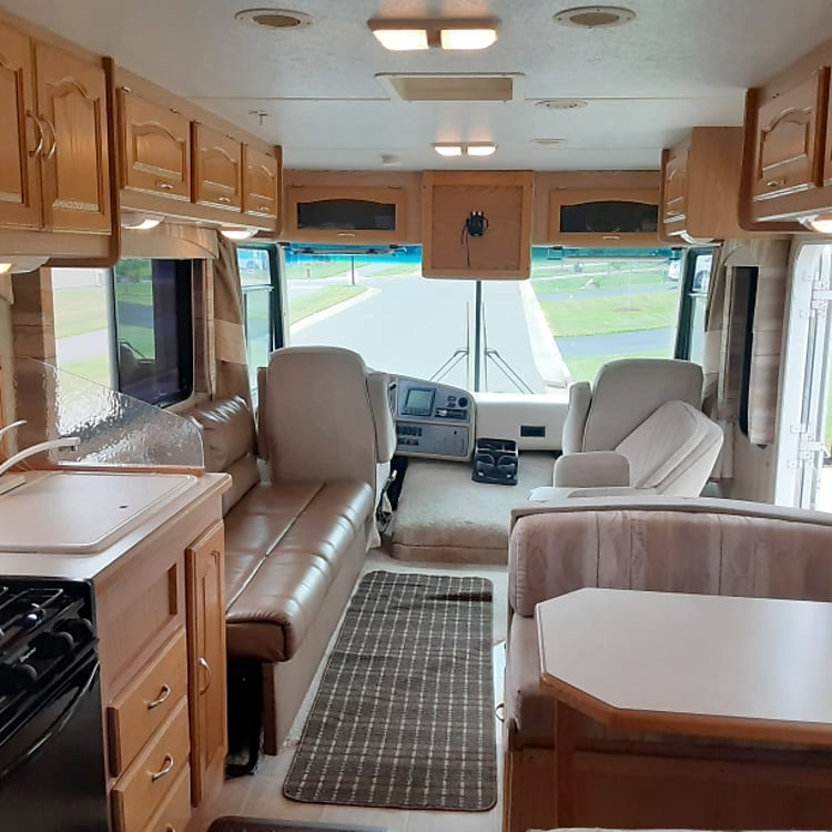 View from kitchen up to front of RV.  Huge window view
