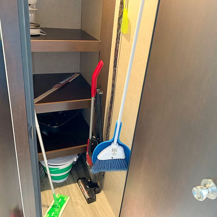 Walk-in pantry w/supplied cleaning tools and games for your camping adventure.