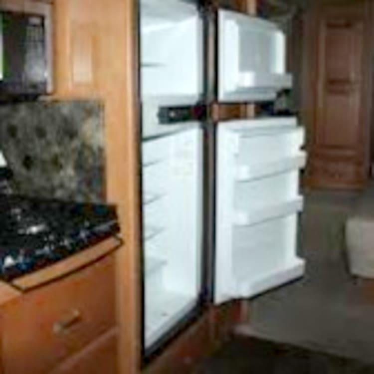 Propane oven and a convection oven/microwave make cooking easy on electric or off grid.