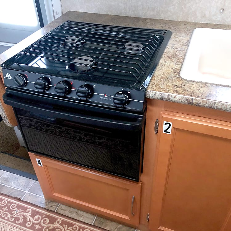 Three propane burners and a small oven.