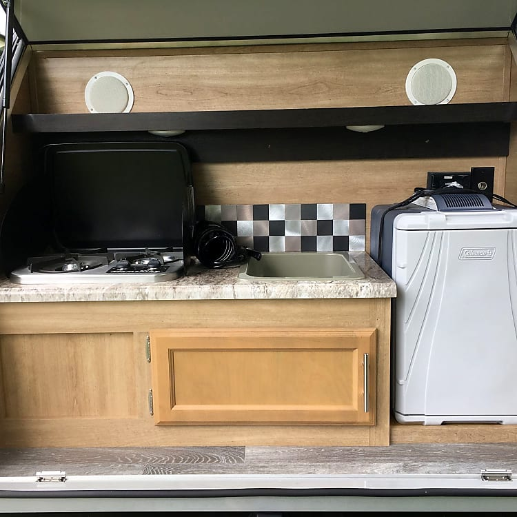 Cook top, sink, and refrigerator