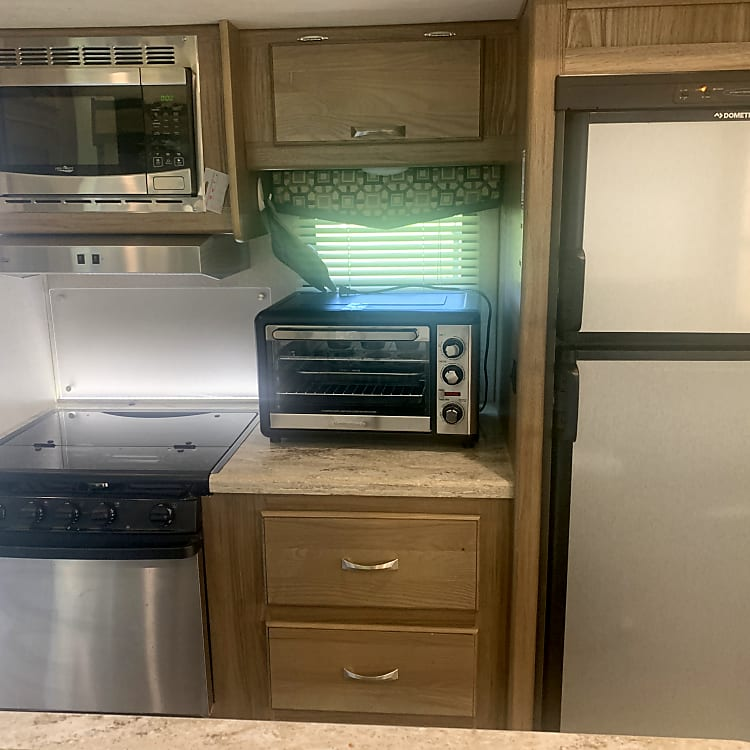 Propane stove and cooktop and electric oven and microwave