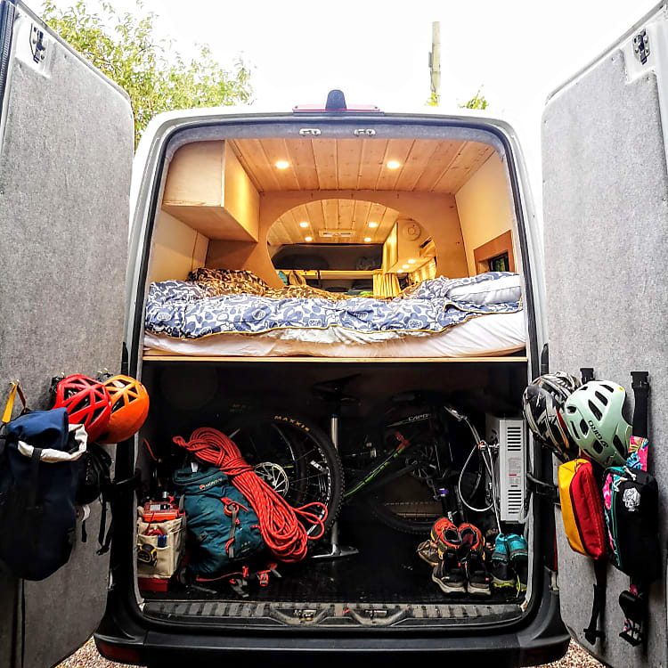 Huge Garage space in the rear of the van! Space to hang all of your gear! 2 bikes and gear, tons of climbing gear & a Shower!