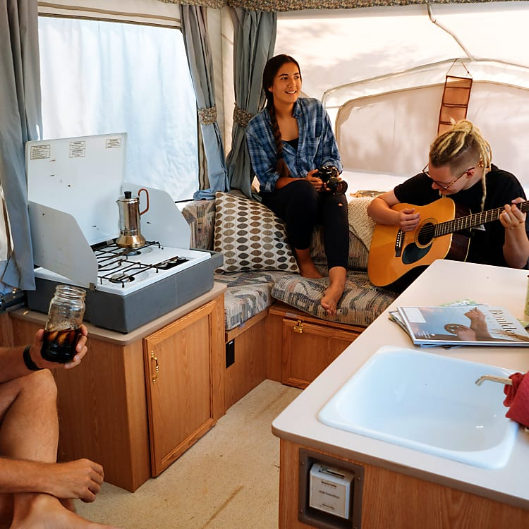 Paul with his cold brew, and the kids playing guitar.  Note the thermostat at the edge of the sink.  That controls the propane heater.