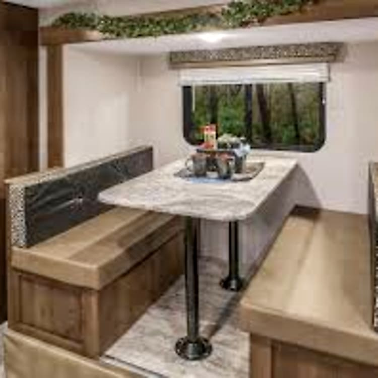 Pop out dinette, storage under the seats